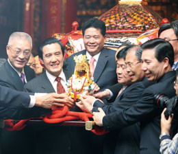 'Yen Ching Piao(well-known underworld figure, former elected politician, and leader of the Dajia Mazu Temple) seen here with Ma Ying Jeou and Wu Den Yih'