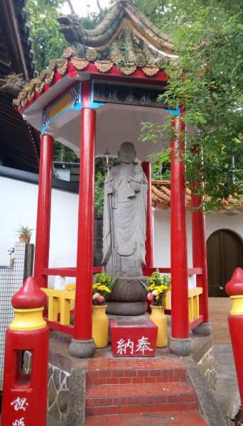 Guarding the gates to hell: The Ksitigharba statue at Puji Temple in Taipei's Beitou District.